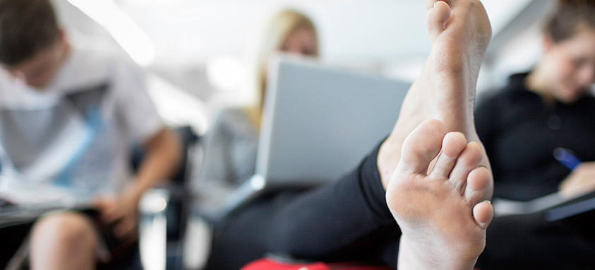 Travel Etiquette: Check Your Feet at the Ticket Counter