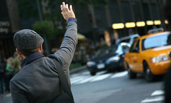 Man Hails Yellow Taxi Cab